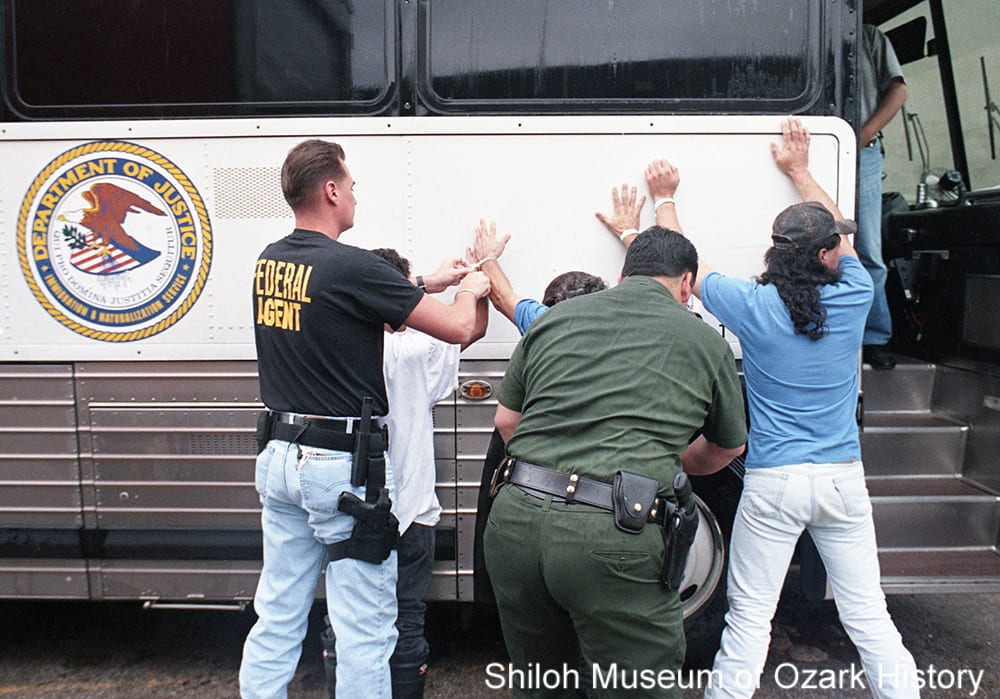 Officers with the U.S. Immigration and Naturalization Service detain workers suspected of being illegal immigrants at George's Inc., Springdale, Arkansas, September 19, 1995.