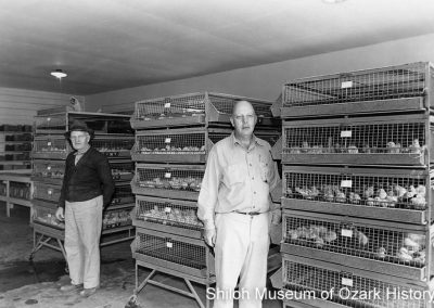 """William Patrick (left) and Benjamin """"Pat"""" Patrick at Pat's Hatchery, Springdale, Arkansas, 1950s–1960s."""